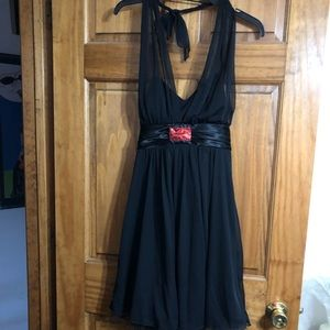 Black halter top dress with red glitter detail